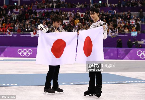 Silver medal winner Shoma Uno of Japan and gold medal winner Yuzuru Hanyu of Japan celebrate during the victory ceremony for the Men's Single Free...