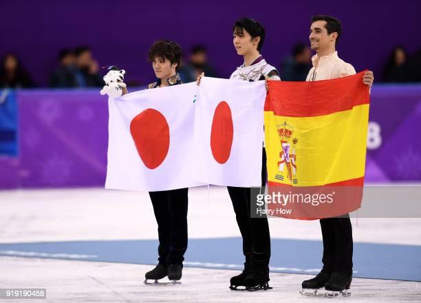 Silver medal winner Shoma Uno of Japan gold medal winner Yuzuru Hanyu of Japan and bronze medal winner Javier Fernandez of Spain celebrate during the...