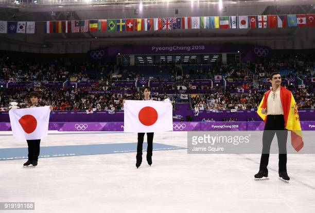 Silver medal winner Shoma Uno of Japan gold medal winner Yuzuru Hanyu of Japan and bronze medal winner Javier Fernandez of Spain celebrate during the...
