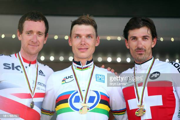 Silver medal winner Sir Bradley Wiggins of Great Britain, gold medal winner Tony Martin of Germany and bronze medal winner Fabian Cancellara of...