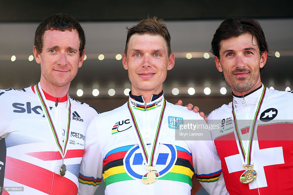 Silver medal winner Sir Bradley Wiggins of Great Britain, gold medal winner Tony Martin of Germany and bronze medal winner Fabian Cancellara of Switzerland pose on the podium after the Elite Men's Time Trial, from Montecatini Terme to Florence on September 25, 2013 in Florence, Italy.