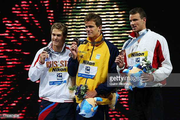 Silver medal winner Vladimir Morozov of Russia Gold medal winner Cesar Cielo Filho of Brazil and Bronze medal winner George Richard Bovell of...