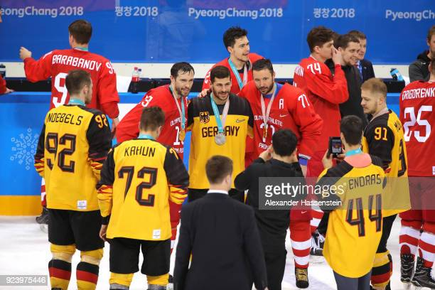 Silver medal winner Yasin Ehliz of Germany poses with gold medal winners Pavel Datsyuk and Ilya Kovalchuk of Olympic Athlete from Russia after the...