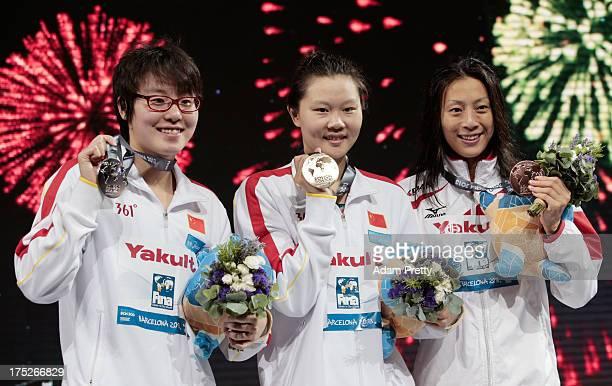 Silver medal winner Yuanhui Fu of China Gold medal winner Jing Zhao of China and Bronze medal winner Aya Terakawa of Japan celebrate on the podium...