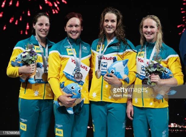Silver medal winners Alicia Coutts Kylie Palmer Brittany Elmslie and Bronte Barratt of Australia celebrate on the podium after the Swimming Women's...