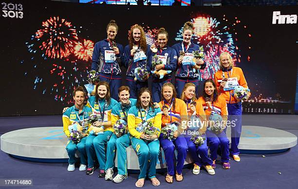 Silver Medal winners Australia Gold Medal winners USA and Bronze Medal winners the Netherlands celebrate on the podium after the Swimming...