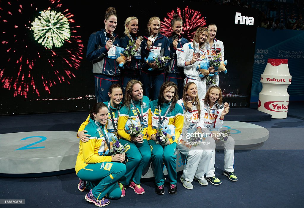 Silver medal winners Australia, Gold medal winners USA and Bronze medal winners Russia celebrate on the podium after the Swimming Women's Medley 4x100m Relay Final on day sixteen of the 15th FINA World Championships at Palau Sant Jordi on August 4, 2013 in Barcelona, Spain.