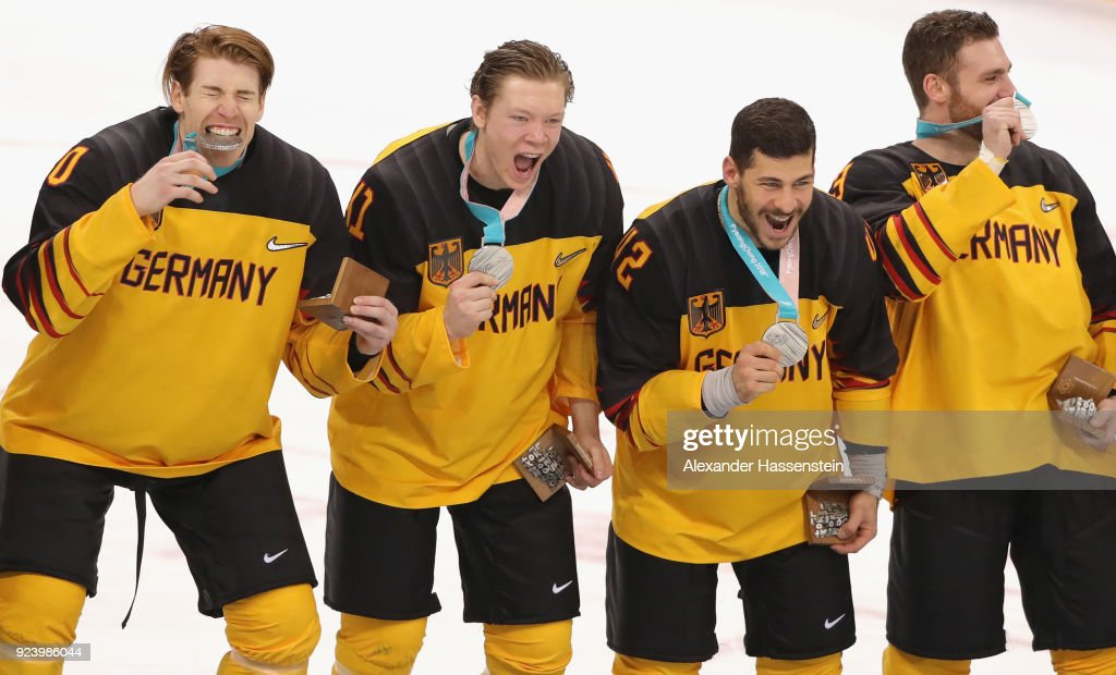 Silver medal winners (L-R) Bjoern Krupp, Jonas Mueller, Yazin Ehliz and Gerrit Fauser react during the medal ceremony after being defeated by Olympic Athletes from Russia 4-3 in overtime during the Men's Gold Medal Game on day sixteen of the PyeongChang 2018 Winter Olympic Games at Gangneung Hockey Centre on February 25, 2018 in Gangneung, South Korea.