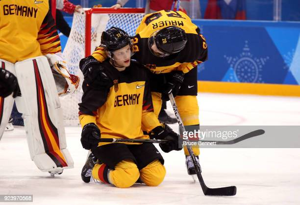 Silver medal winners Dominik Kahun and Frank Mauer of Germany react after being defeated by Olympic Athletes from Russia 4-3 in overtime during the...