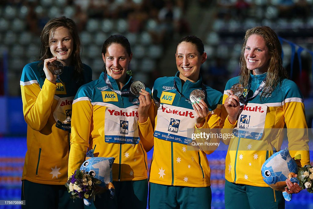 Silver medal winners Emily Seebohm, Sally Foster, Cate Campbell and Alicia Coutts celebrate on the podium after the Swimming Women's Medley 4x100m Relay Final on day sixteen of the 15th FINA World Championships at Palau Sant Jordi on August 4, 2013 in Barcelona, Spain.