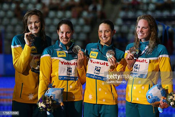 Silver medal winners Emily Seebohm Sally Foster Cate Campbell and Alicia Coutts celebrate on the podium after the Swimming Women's Medley 4x100m...