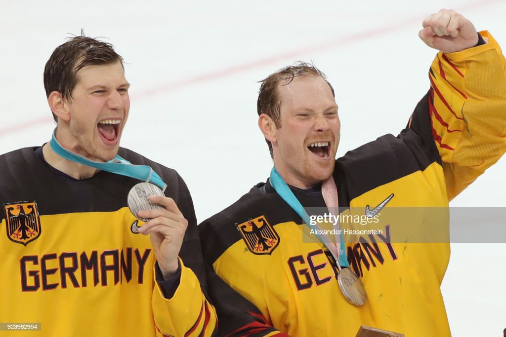 Silver medal winners Frank Mauer (L) and Danny Aus Den Birken react during the medal ceremony after being defeated by Olympic Athletes from Russia 4-3 in overtime during the Men's Gold Medal Game on day sixteen of the PyeongChang 2018 Winter Olympic Games at Gangneung Hockey Centre on February 25, 2018 in Gangneung, South Korea.