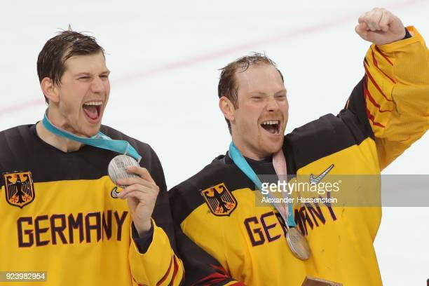 Silver medal winners Frank Mauer and Danny Aus Den Birken react during the medal ceremony after being defeated by Olympic Athletes from Russia 43 in...