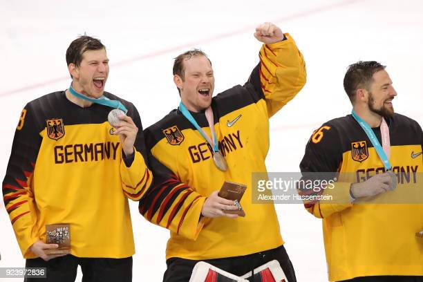 Silver medal winners Frank Mauer Danny Aus Den Birken and Yannic Seidenberg of Germany react during the medal ceremony after being defeated by...
