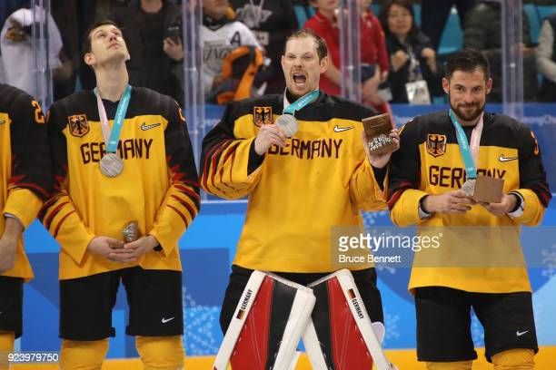 Silver medal winners Frank Mauer Danny Aus Den Birken and Yannic Seidenberg of Germany react during the medal ceremony for the Men's Gold Medal Game...