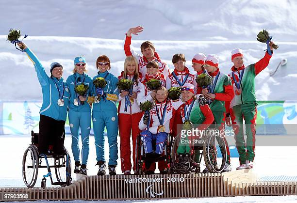 Silver medal winners from Belarus gold medal winners from Russia and bronze medal winner from Belarus wave to the crowd after the medal ceremony in...