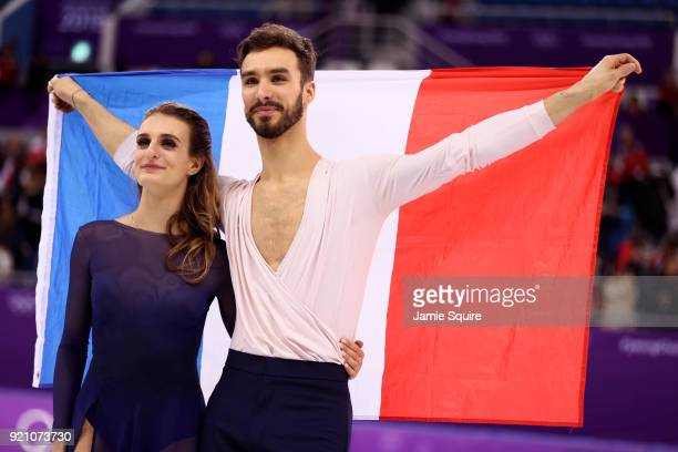 Silver medal winners Gabriella Papadakis and Guillaume Cizeron of France celebrate during the victory ceremony for the Figure Skating Ice Dance Free...