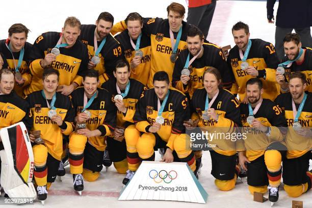 Silver medal winners Germany celebrate during the medal ceremony after being defeated by Olympic Athletes from Russia 43 in overtime in the Men's...