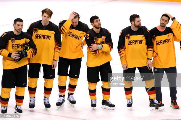Silver medal winners Germany look on after being defeated by Olympic Athletes from Russia 43 in overtime during the Men's Gold Medal Game on day...