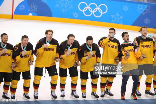 Silver medal winners Germany react during the medal ceremony after being defeated by Olympic Athletes from Russia 43 in overtime during the Men's...