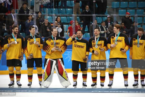 Silver medal winners Germany react during the medal ceremony after being defeated by Olympic Athletes from Russia 43 in overtime in the Men's Gold...