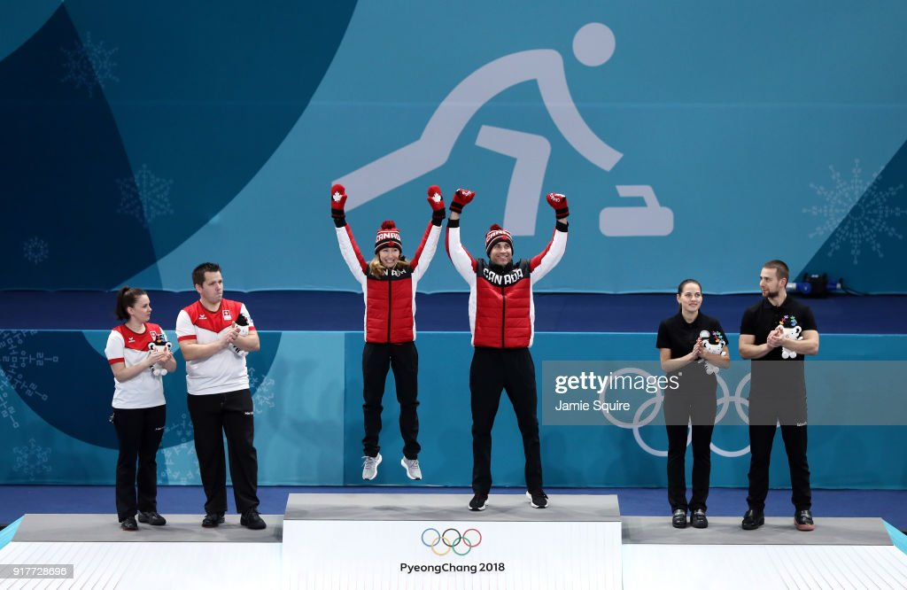 Silver medal winners Jenny Perret and Martin Rios of Switzerland, Gold medal winners Kaitlyn Lawes and John Morris of Canada, and Anastasia Bryzgalova and bronze medal winners Aleksandr Krushelnitckii of Olympic Athletes from Russia pose during the victory ceremony after Curling Mixed Doubles Gold Medal Game on day four of the PyeongChang 2018 Winter Olympic Games at Gangneung Curling Centre on February 13, 2018 in Gangneung, South Korea.