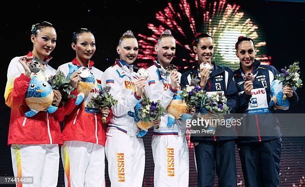 Silver medal winners Jiang Tingting and Jiang Wenwen of China Gold medal winners Svetlana Kolesnichenko and Svetlana Romashina of Russia and bronze...