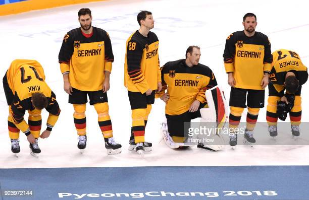 Silver medal winners Marcus Kink Matthias Plachta Frank Mauer Danny Aus Den Birken Yannic Seidenberg and Patrick Reimer of Germany look on after...