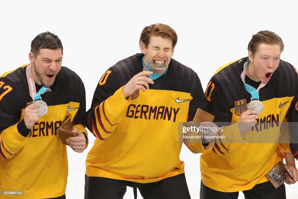 Silver medal winners Patrick Reimer (L), Bjoern Krupp (C) and Jonas Mueller react during the medal ceremony after being defeated by Olympic Athletes from Russia 4-3 in overtime during the Men's Gold Medal Game on day sixteen of the PyeongChang 2018 Winter Olympic Games at Gangneung Hockey Centre on February 25, 2018 in Gangneung, South Korea.