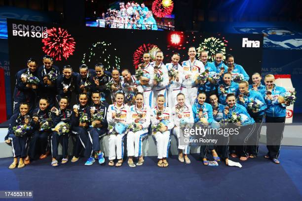 Silver medal winners Spain Gold medal winners Russia and Bronze medal winners Ukraine celebrate after during the Synchronized Swimming Free...