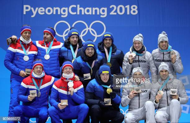 Silver medal winners team Norway gold medal winners team Sweden and bronze medal winners team Germany celebrate during the medal ceremony for the...