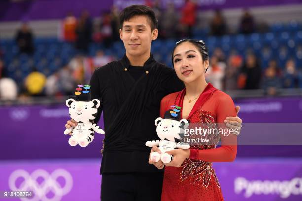 Silver medal winners Wenjing Sui and Cong Han of China celebrate during the victory ceremony after the Pair Skating Free Skating at Gangneung Ice...