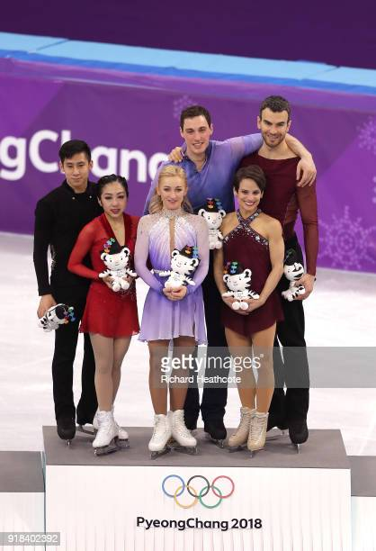 Silver medal winners Wenjing Sui and Cong Han of China, gold medal winners Aljona Savchenko and Bruno Massot of Germany and bronze medal winners...