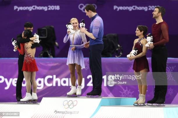 Silver medal winners Wenjing Sui and Cong Han of China gold medal winners Aljona Savchenko and Bruno Massot of Germany and bronze medal winners...
