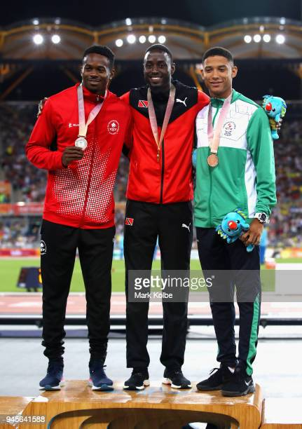 Silver medalist Aaron Brown of Canada gold medalist Hereem Richards of Trinidad and Tobago and bronze medalist Leon Reid of Northern Ireland pose...
