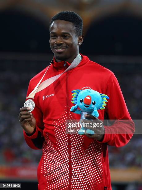 Silver medalist Aaron Brown of Canada looks on during the medal ceremony for the Men's 200 metres during athletics on day nine of the Gold Coast 2018...