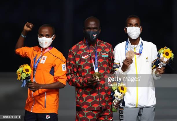 Silver medalist Abdi Nageeye of Team Netherlands, gold medalist Eliud Kipchoge of Team Kenya and bronze medalist Bashir Abdi of Team Belgium pose...
