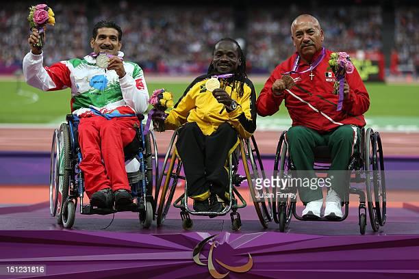 Silver medalist Abdolreza Jokar of the Islamic Republic of Iran gold medalist Alphanso Cunningham of Jamaica and bronze medalist Mauro Maximo De...