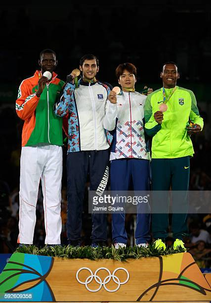 Silver medalist Abdoulrazak Issoufou Alfaga of Niger Gold medalist Radik Isaev of Azerbaijan and Bronze medalists Dongmin Cha of Korea and Maicon...