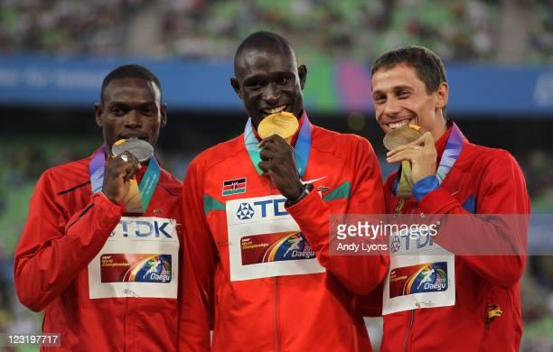 Silver medalist Abubaker Kaki of Sudan gold medalist David Lekuta Rudisha of Kenya and bronze medalist Yuriy Borzakovskiy of Russia celebrate on the...