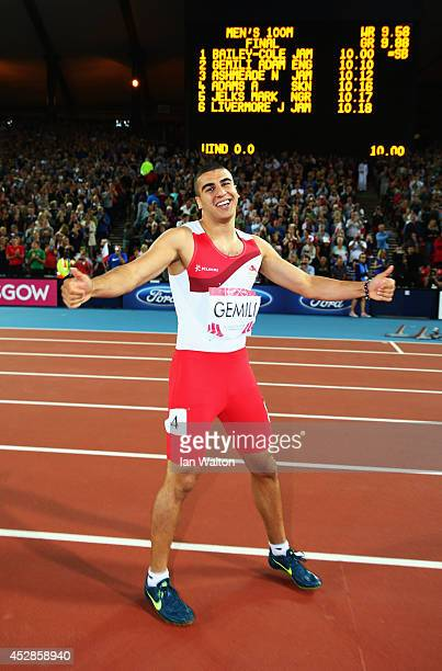 Silver medalist Adam Gemili of England celebrates after the Men's 100 metres final at Hampden Park during day five of the Glasgow 2014 Commonwealth...