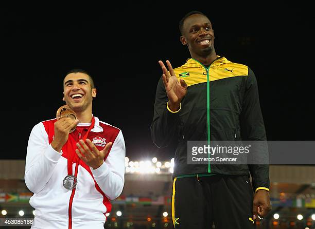 Silver medalist Adam Gemili of England talks to gold medalist Usain Bolt of Jamaica during the medal ceremony for the Men's 4x100 metres relay at...