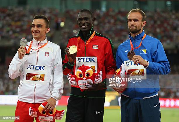 Silver medalist Adam Kszczot of Poland gold medalist David Lekuta Rudisha of Kenya and bronze medalist Amel Tuka of Bosnia and Herzegovina pose on...