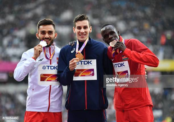 Silver medalist Adam Kszczot of Poland , gold medalist Pierre-Ambroise Bosse of France and bronze medalist Kipyegon Bett of Kenya pose with their...