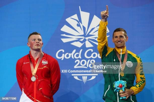 Silver medalist Adam Peaty of England and gold medalist Cameron Van Der Burgh of South Africa pose during the medal ceremony for the Men's 50m...