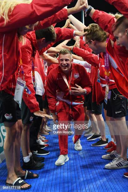 Silver medalist Adam Peaty of England celebrates following the medal ceremony for the Men's 4 x 100m Medley Relay Final on day six of the Gold Coast...