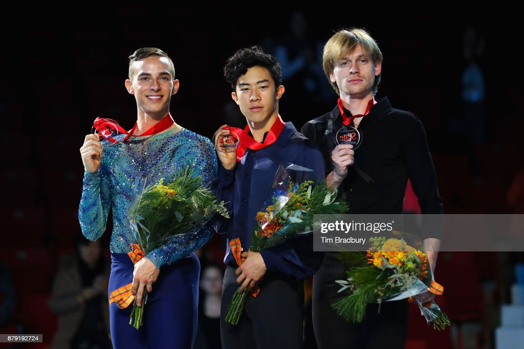 Silver medalist Adam Rippon of the United States, gold medalist Nathan Chen of the United States, and bronze medalist Sergei Voronov of Russia, pose after competing in the Men's Free Skating during day two of 2017 Bridgestone Skate America at Herb Brooks Arena on November 25, 2017 in Lake Placid, New York.