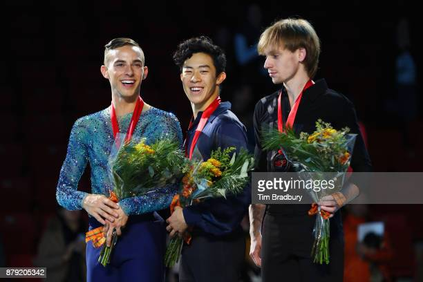 Silver medalist Adam Rippon of the United States gold medalist Nathan Chen of the United States and bronze medalist Sergei Voronov of Russia pose...