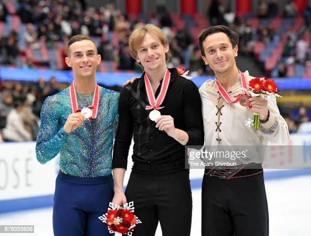 Silver medalist Adam Rippon of United States gold medalist Sergei Voronov of Russia and bronze medalist Alexei Bychenko of Israel pose for...