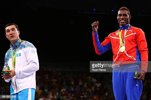 Silver medalist Adilbek Niyazymbetov of Kazakhstan and gold medalist Julio Cesar La Cruz of Cuba stand on the podium during the medal ceremony for...
